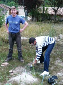 John makes sure his trousers don't fall down while Rob does the hard work.